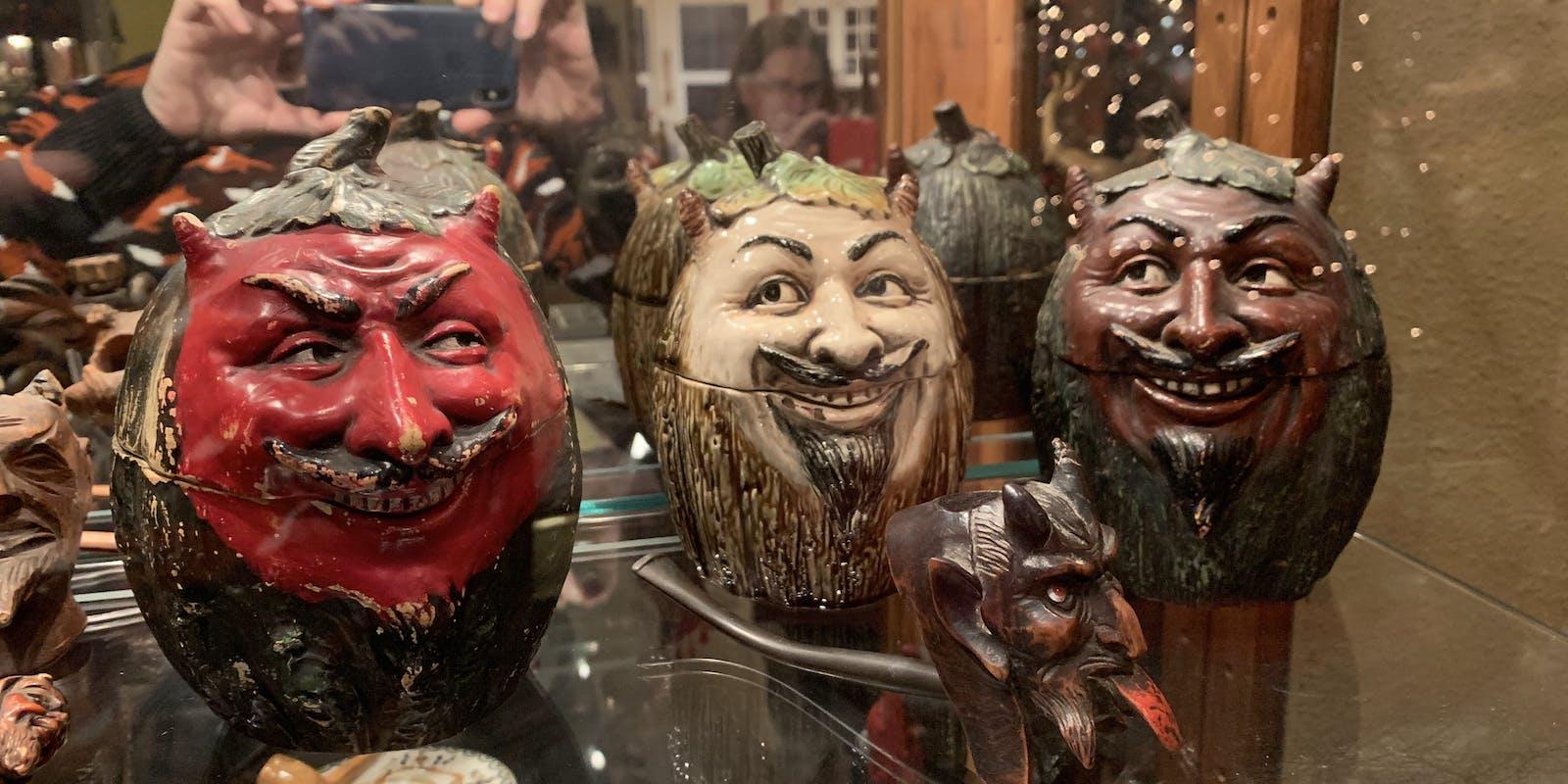 A trio of devilish mugs.