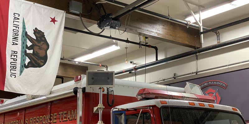 The bulb hanging from the fire station ceiling.