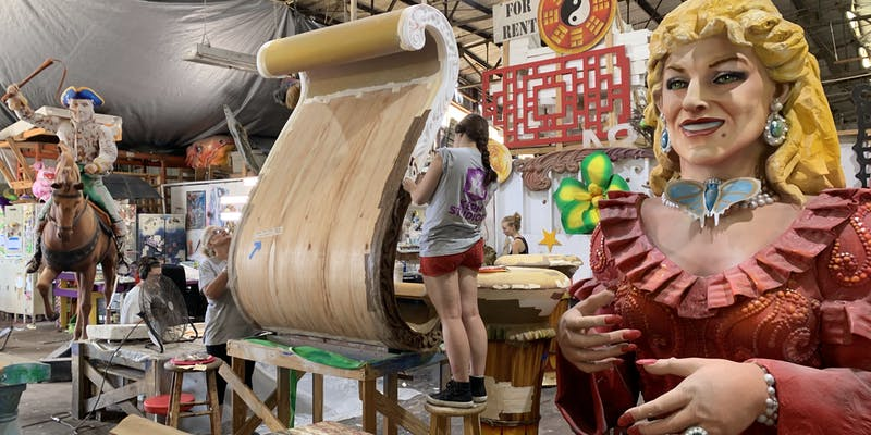 An artist working on a piece for a float